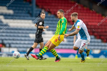 Ewood Park, Blackburn, Lancashire, England; Jake Livermore of West Bromwich Albion plays the ball back under pressure from Adam Armstrong of Blackburn Rovers; English Football League Championship Football, Blackburn Rovers versus West Bromwich Albion.