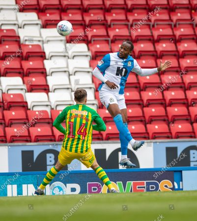 Ewood Park, Blackburn, Lancashire, England; Ryan Nyambe of Blackburn Rovers rises above Conor Townsend of West Bromwich Albion to head the ball forward; English Football League Championship Football, Blackburn Rovers versus West Bromwich Albion.
