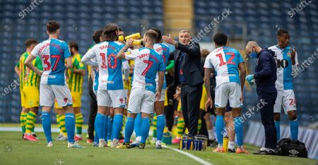 Ewood Park, Blackburn, Lancashire, England; Blackburn Rovers manager Tony Mowbray communicates to his players at the drinks break; English Football League Championship Football, Blackburn Rovers versus West Bromwich Albion.