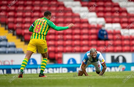 Ewood Park, Blackburn, Lancashire, England; Jake Livermore of West Bromwich Albion fouls Bradley Johnson of Blackburn Rovers; English Football League Championship Football, Blackburn Rovers versus West Bromwich Albion.