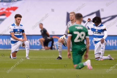 Queens Park Rangers players take a knee prior to the Sky Bet League Championship match between Queens Park Rangers and Sheffield Wednesday at The Kiyan Prince Foundation Stadium in London, UK - 11th July 2020