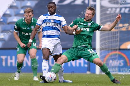 Olamide Shodipo of Queens Park Rangers and Julian Borner of Sheffield Wednesday in action during Sky Bet League Championship match between Queens Park Rangers and Sheffield Wednesday at The Kiyan Prince Foundation Stadium in London, UK - 11th July 2020