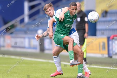 Ryan Manning of Queens Park Rangers and Alessio da Cruz of Sheffield Wednesday in action during Sky Bet League Championship match between Queens Park Rangers and Sheffield Wednesday at The Kiyan Prince Foundation Stadium in London, UK - 11th July 2020