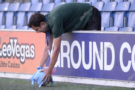 A member of staff retrieves a ball during Sky Bet League Championship match between Queens Park Rangers and Sheffield Wednesday at The Kiyan Prince Foundation Stadium in London, UK - 11th July 2020