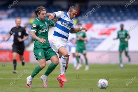 Geoff Cameron of Queens Park Rangers and Josh Windass of Sheffield Wednesday in action during Sky Bet League Championship match between Queens Park Rangers and Sheffield Wednesday at The Kiyan Prince Foundation Stadium in London, UK - 11th July 2020