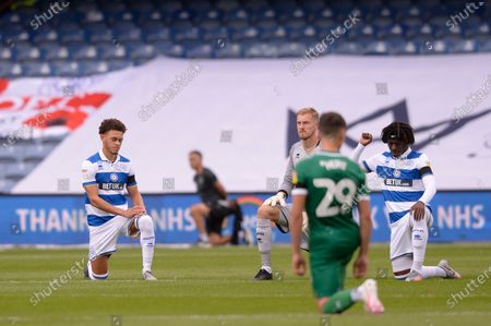 Queens Park Rangers players (L-R) Luke Amos, Joe Lumley and Eberechi Eze  take a knee prior to the Sky Bet League Championship match between Queens Park Rangers and Sheffield Wednesday at The Kiyan Prince Foundation Stadium in London, UK - 11th July 2020