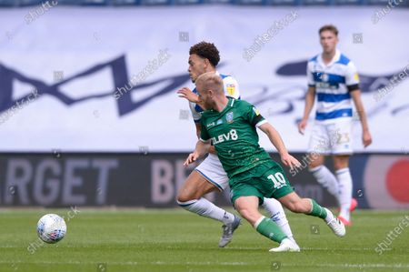 Luke Amos of Queens Park Rangers and Barry Bannan of Sheffield Wednesday in action during Sky Bet League Championship match between Queens Park Rangers and Sheffield Wednesday at The Kiyan Prince Foundation Stadium in London, UK - 11th July 2020