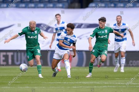 Luke Amos (C) of Queens Park Rangers and Barry Bannan (L) and Alex Hunt (R) of Sheffield Wednesday in action during Sky Bet League Championship match between Queens Park Rangers and Sheffield Wednesday at The Kiyan Prince Foundation Stadium in London, UK - 11th July 2020