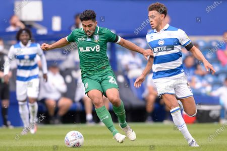 Luke Amos of Queens Park Rangers and Massimo Luongo of Sheffield Wednesday in action during Sky Bet League Championship match between Queens Park Rangers and Sheffield Wednesday at The Kiyan Prince Foundation Stadium in London, UK - 11th July 2020