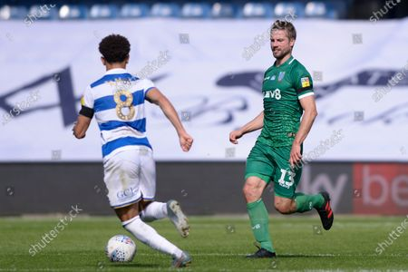 Luke Amos of Queens Park Rangers and Julian Borner of Sheffield Wednesday in action during Sky Bet League Championship match between Queens Park Rangers and Sheffield Wednesday at The Kiyan Prince Foundation Stadium in London, UK - 11th July 2020
