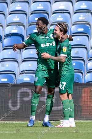 Josh Windass (R) of Sheffield Wednesday celebrates putting his team 2-0 up with Dominic Iorfa (L) during Sky Bet League Championship match between Queens Park Rangers and Sheffield Wednesday at The Kiyan Prince Foundation Stadium in London, UK - 11th July 2020