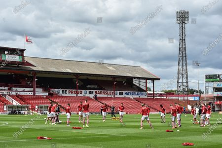 Barnsley FC players warm up prior to the behind closed doors match with Wigan Athletic.