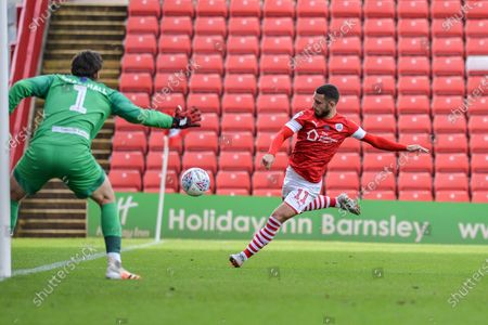 Conor Chaplin (11) of Barnsley FC gets a shot away only to be denied