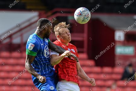 Nathan Byrne (2) of Wigan Athletic and Callum Styles (20) of Barnsley FC challenge for ball.