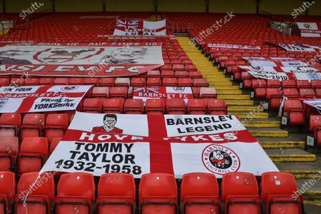 Flags replace fans in the stands at Barnsley FC.