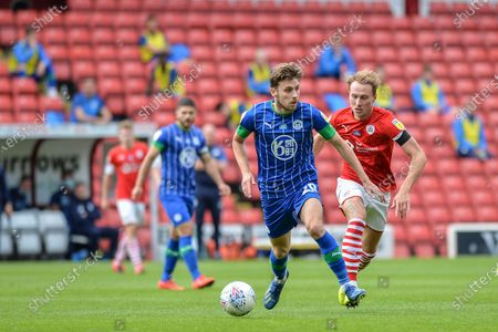 Joe Williams (20) of Wigan Athletic with the ball