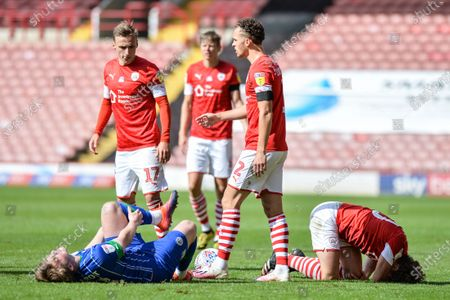 Joe Gelhardt (38) of Wigan Athletic and Callum Styles (20) of Barnsley FC both on the floor injured after a tackle.
