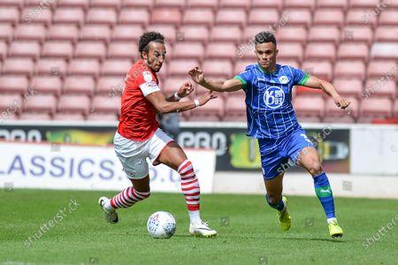 Antonee Robinson (3) of Wigan Athletic goes around Jacob Brown (7) of Barnsley FC