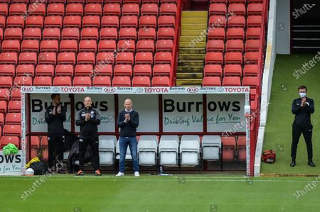 Gerhard Struber manager of Barnsley FC joins in the minutes applause for Jack Charlton.