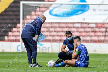 Antonee Robinson (3) of Wigan Athletic receives treatment