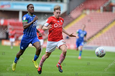 Kilian Ludewig (14) of Barnsley FC shields the ball from Jamal Lowe (9) of Wigan Athletic