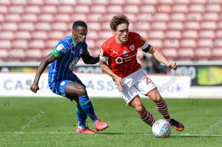 Callum Styles (20) of Barnsley FC takes on Nathan Byrne (2) of Wigan Athletic