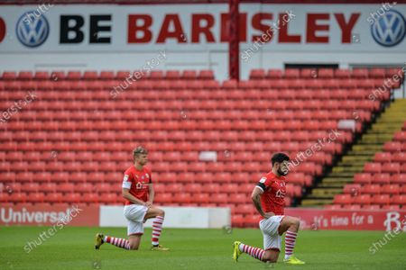 Alex Mowatt (27) Captain of Barnsley FC take the knee in support of Black Lives Matter movement