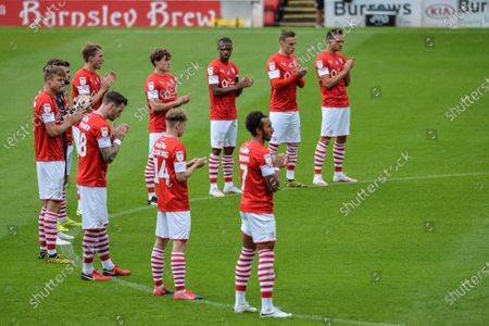 Players from Barnsley FC take part in a minutes applause for former England World Cup winner Jack Charlton who died aged 85