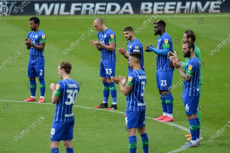 Players from Wigan Athletic take part in a minutes applause for former England World Cup winner Jack Charlton who died aged 85