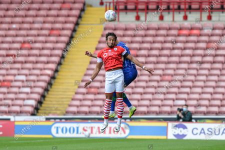 Jacob Brown (7) of Barnsley FC wins the battle in the air.
