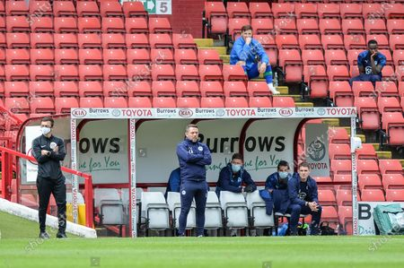 Paul Cook manager of Wigan Athletic looks on as his team attack.