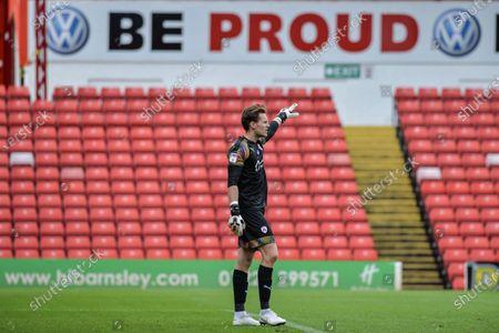 Goalkeeper  Jack Walton (13) of Barnsley FC offer instruction