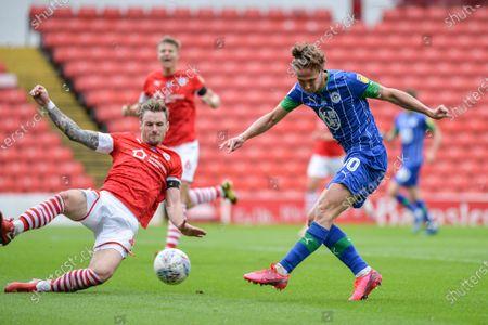 Kieran Dowell (30) of Wigan Athletic takes a shot.