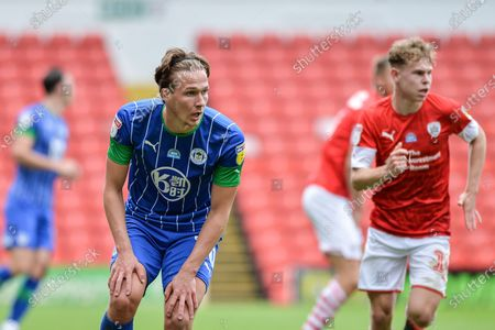 Kieran Dowell (30) of Wigan Athletic reacts after blocked shot