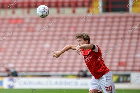 Callum Styles (20) of Barnsley FC take a throw in