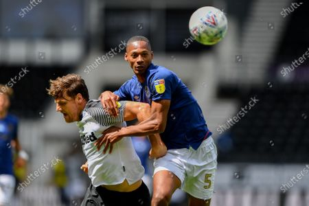 Ethan Pinnock (5) of Brentford battles with Chris Martin (19) of Derby County