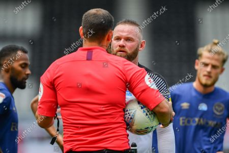 Wayne Rooney (32) of Derby County discusses the decision by Referee Tim Robinson