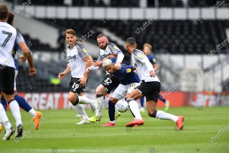 Said Benrahma (10) of Brentford battles with Wayne Rooney (32) of Derby County