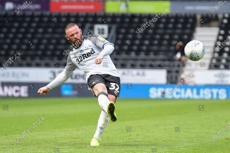 Wayne Rooney (32) of Derby County takes a free kick