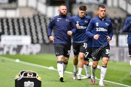 Wayne Rooney (32) of Derby County warms up with his team mates