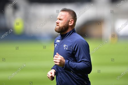Wayne Rooney (32) of Derby County warms up