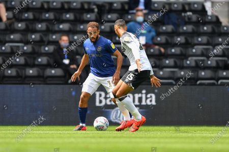 Bryan Mbeumo (19) of Brentford battles with Max Lowe (25) of Derby County
