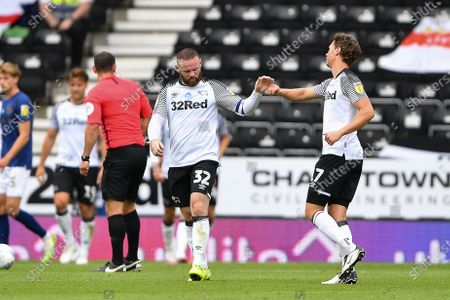 Wayne Rooney (32) of Derby County celebrates with George Evans (17) after his side scored a goal to make it 1-1