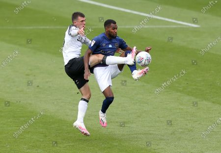Derby County's Jason Knight battles with Brentford's Rico Henry