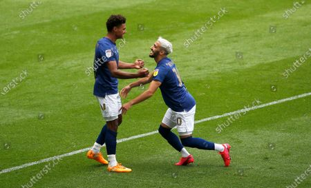 Brentford's Said Benrahma celebrates the first goal with scorer Oliver Watkins