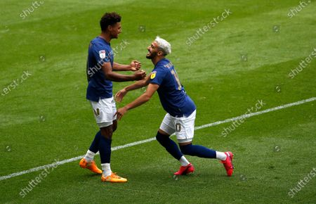 Brentford's Oliver Watkins celebrates the first goal with  Said Benrahma
