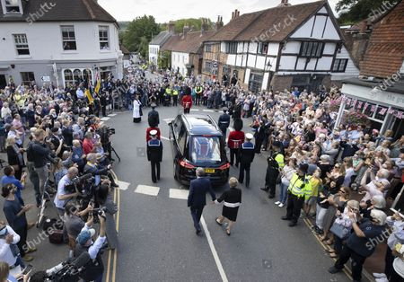 The funeral cortege carrying the body of WWII Forces' Sweetheart Dame Vera Lynn passes through her home village Ditchling, East Sussex followed on foot by her daughter Virginia Lewis-Jones and husband Tom. The cortege will head to a crematorium in Brighton for a private funeral. A Battle of Britain Memorial Flight flypast, consisting of a Spitfire and a Hurricane, will perform a flypast at noon.
