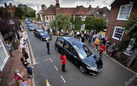 The funeral cortege carrying the body of WWII Forces' Sweetheart Dame Vera Lynn passes through her home village Ditchling, East Sussex. The cortege will head to a crematorium in Brighton for a private funeral. A Battle of Britain Memorial Flight flypast, consisting of a Spitfire and a Hurricane, will perform a flypast at noon.