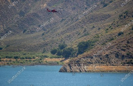 A US Coast Guard helicopter searches Lake Piru for missing actress Naya Rivera on Thursday, July 9, 2020 in Lake Piru, CA. (Brian van der Brug / Los Angeles Times)