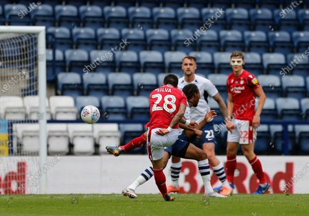Deepdale Stadium, Preston, Lancashire, England; Tiago Silva of Nottingham Forest fires in his shot from the edge of the box as Daniel Johnson of Preston North End challenges; English Championship Football, Preston North End versus Nottingham Forest.